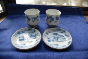 Two Matching Cup and Saucer Sets with a Japanese, Imari Painting style