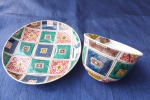 A pair of Matching Cup and Saucer Set with Kutani Painting